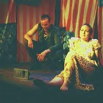 "Scene from the play, ""Alchemy of Desire / Dead Man's Blues (Text with Songs)"""