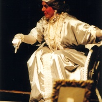 "Photograph of Déxter Cápiro (La señora) in the production, ""El álbum"""