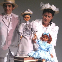 Photograph of Yerandy Basart (Caballero 3) and Fara Madrigal (Dama 1) in the theatrical production, Los zapaticos de rosa